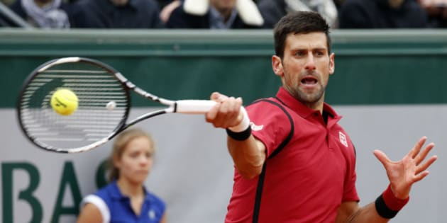 Tennis - French Open Mens Singles Semifinal match - Roland Garros - Novak Djokovic of Serbia v Dominic Thiem of Austria - Paris, France - 03/06/16. Novak Djokovic returns a shot. REUTERS/Jacky Naegelen