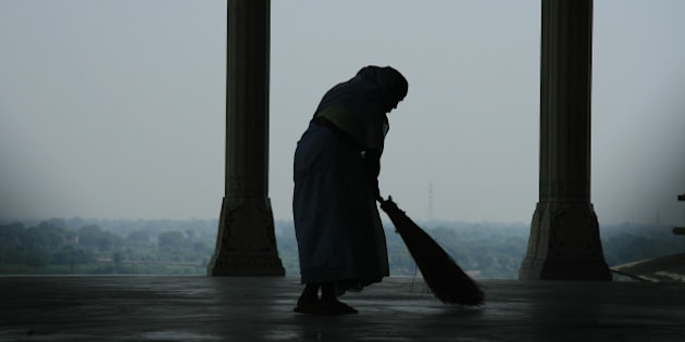 This is a photograph of a lone sweeper cleaning the floors of Agra Fort. Who knows what she is thinking as she assumes her daily chores surrounded by such tranquil settings