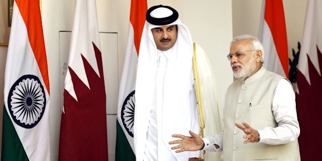 NEW DELHI, INDIA - MARCH 25: Emir of the State of Qatar Sheikh Tamim bin Hamad Al-Thani in conversatio with Prime Minister Narendra Modi prior to a meeting on March 25, 2015 in New Delhi, India. India and Qatar inked six agreements, including one on transfer of sentenced prisoners. Around 600,000 Indian nationals work in Qatar, comprising the largest expatriate community in Qatar. (Photo by Ajay Aggarwal/Hindustan Times via Getty Images)