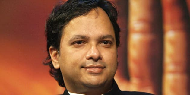 FRANKFURT/MAIN, GERMANY:  Indian author Vikram Chandra discusses his work on the set of a German TV channel at the Frankfurt Book Fair 05 October 2006. The Fair has brought together a record 7,272 exhibitors from more than 100 countries, and is spotlighting India this year as its guest country with a packed program of readings and debates.     AFP PHOTO JOHN MACDOUGALL  (Photo credit should read JOHN MACDOUGALL/AFP/Getty Images)