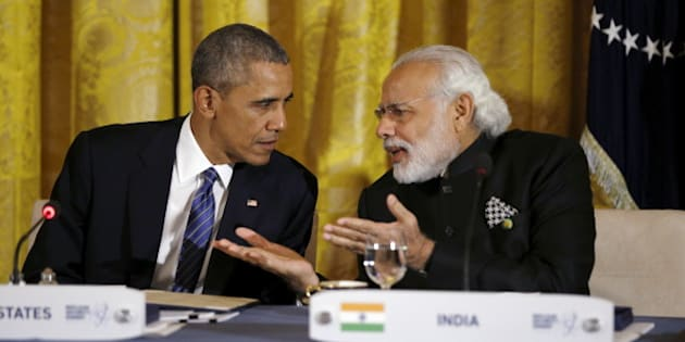 U.S. President Barack Obama talks with Indian Prime Minister Narendra Modi (R) during a working dinner at the White House with heads of delegations attending the Nuclear Security Summit in Washington March 31, 2016. REUTERS/Kevin Lamarque