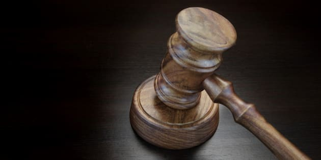 Judges Or Auctioneer Gavel On Black Wood Grunge Background, Top View, Close-Up.