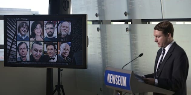 The images of French sartirical newspaper 'Charlie Hebdo' journalists who were killed in a terrorist attack are seen during the re-dedication of the Newseum Journalists Memorial on June 6, 2016 at the Newseum in Washington, DC. / AFP / MANDEL NGAN        (Photo credit should read MANDEL NGAN/AFP/Getty Images)