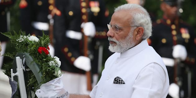ARLINGTON, VA - JUNE 06: Indian Prime Minister Narendra Modi lays a wreath at the Tomb of the Unknown Soldier at Arlington National Cemetery, June 6, 2016 in Arlington, Virginia. The Prime Minister will meet with President Barack Obama on June 7.  (Photo by Mark Wilson/Getty Images)