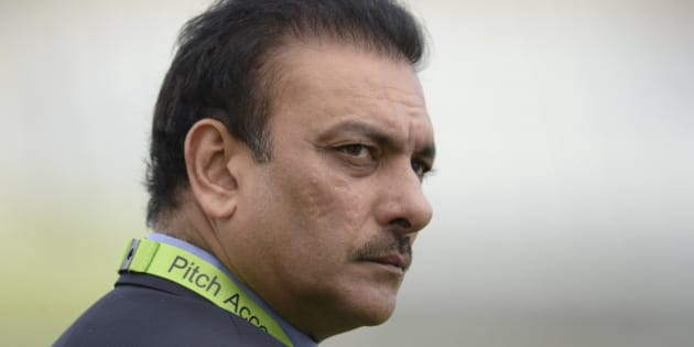 India's director of cricket Ravi Shastri looks on before the third one-day international cricket match against England at Trent Bridge cricket ground, Nottingham, England  August 30, 2014.  REUTERS/Philip Brown (BRITAIN - Tags: SPORT CRICKET)