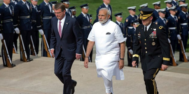 Indian Prime Minister Narendra Modi, center, with Secretary of Defense Ash Carter, left, and, Maj. Gen. Bradley Becker, right, walk up the steps to lay a wreath at the Tomb of the Unknowns at Arlington National Cemetery, in Arlington, Va., Monday, June 6, 2016. (AP Photo/Manuel Balce Ceneta)