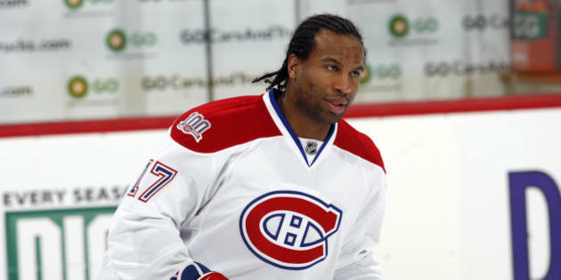 Montreal Canadiens right winger George Laraque warms up before facing the Colorado Avalanche in the first period of an NHL hockey game in Denver on Friday, Feb. 13, 2009. (AP Photo/David Zalubowski)