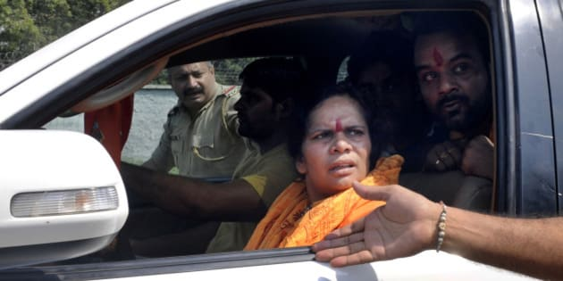 DADRI, INDIA - OCTOBER 7: BJP leader Sadhvi Prachi convoy stopped from entering Bisada on October 7, 2015 in Dadri, India. Last week a 50-year-old man, Mohammad Akhlaq (Ikhlaq), was lynched for allegedly buying and eating beef in his house in Bishada village. (Photo by Sunil Ghosh/Hindustan Times via Getty Images)