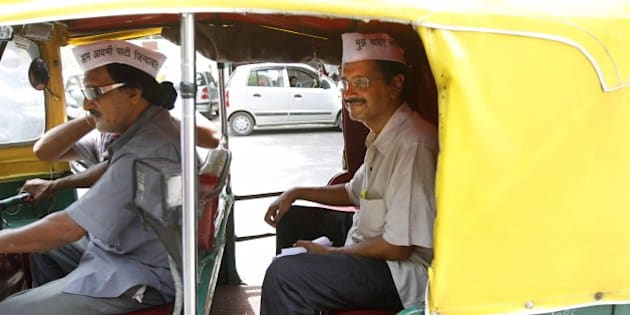 NEW DELHI, INDIA - JUNE 10: Aam Aadmi Party leader Arvind Kejriwal taking ride on Auto rickshaws during auto drivers protest against the Delhi government's plan to ban advertisements on three-wheelers at Janta Mantar on June 10, 2013 in New Delhi, India. (Photo by Virendra Singh Gosain/Hindustan Times via Getty Images)