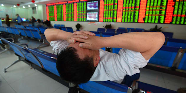 FUYANG, CHINA - MAY 09:  (CHINA OUT) An investor reacts at an exchange hall on May 9, 2016 in Fuyang, Anhui Province of China. Chinese stock market fell sharply on Monday. The Shanghai Composite Index dropped 81.14 points, or 2.79% to 2,832.11 points and the Shenzhen Composite Index fell 310.06 points, or 3.07% to 9,790.48 points.  (Photo by VCG/VCG via Getty Images)