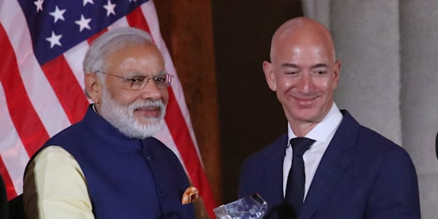 WASHINGTON, DC - JUNE 07: Jeff Bezos, CEO of Amazon,(R), is presented with the 2016 USIBC Global Leadership Award by Indian Prime Minister Narendra Modi during the 41st Annual Leadership Summit at the Mellen Auditorium, June 7, 2016 in Washington, DC. .  (Photo by Mark Wilson/Getty Images)