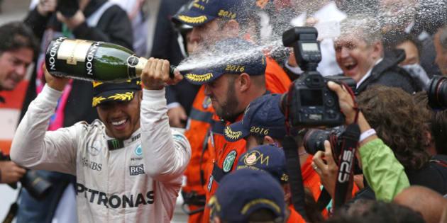 Formula One - Monaco Grand Prix - Monaco - 29/5/16. Mercedes F1 driver Lewis Hamilton celebrates after winning.             REUTERS/Eric Gaillard
