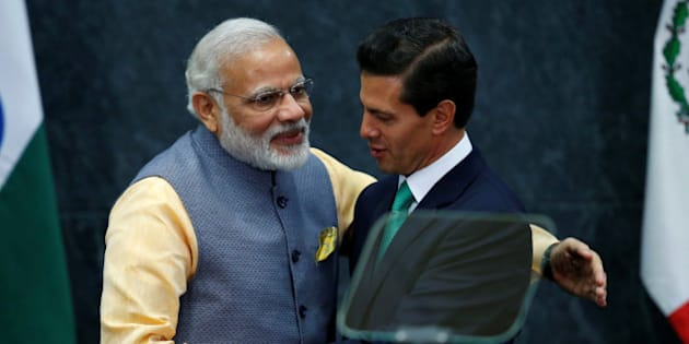 India's Prime Minister Narendra Modi shakes hands with Mexican President Enrique Pena Nieto after they gave a speech, at Los Pinos presidential residence in Mexico City, Mexico, June 8, 2016. REUTERS/Edgard Garrido