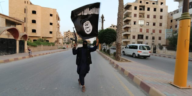 "A member loyal to the Islamic State in Iraq and the Levant (ISIL) waves an ISIL flag in Raqqa June 29, 2014. The offshoot of al Qaeda which has captured swathes of territory in Iraq and Syria has declared itself an Islamic ""Caliphate"" and called on factions worldwide to pledge their allegiance, a statement posted on jihadist websites said on Sunday. The group, previously known as the Islamic State in Iraq and the Levant (ISIL), also known as ISIS, has renamed itself ""Islamic State"" and proclaimed its leader Abu Bakr al-Baghadi as ""Caliph"" - the head of the state, the statement said. REUTERS/Stringer (SYRIA - Tags: POLITICS CIVIL UNREST )  BEST QUALITY AVAILABLE"