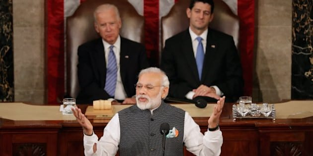 WASHINGTON, DC - JUNE 08:  Indian Prime Minister Narendra Modi addresses a joint meeting of the U.S. Congress with Speaker of the House Paul Ryan (R-WI) (C) and Vice President Joe Biden (2nd L) in the House Chamber of the U.S. Capitol June 8, 2016 in Washington, DC. Modi met with President Barack Obama for bilateral meetings on Tuesday.  (Photo by Chip Somodevilla/Getty Images)