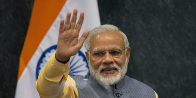 Prime Minister of India Narendra Modi waves following a joint statement to the press with Mexican President Enrique Pena Nieto, in Los Pinos presidential residence in Mexico City, Wednesday, June 8, 2016. Modi met with the Mexican President Wednesday evening during a short working visit to the country.(AP Photo/Rebecca Blackwell)