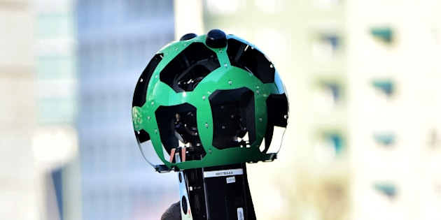Daniele Rizzetto, computer engineer, walks carrying a Street View trekker backpack with a 360° camera system on top, on February 5, 2016 in central Milan. The technology, first introduced in 2012, allows them to capture places around the world inaccessible by car. According to Google, the Trekker is worn by an operator and walked through pedestrian walkways or trails on foot, gathering images as it goes. The images are stitched together to create the 360-degree panoramas seen on Google Maps. AFP PHOTO / GIUSEPPE CACACE / AFP / GIUSEPPE CACACE        (Photo credit should read GIUSEPPE CACACE/AFP/Getty Images)