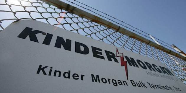 UNITED STATES - AUGUST 28:  A sign hangs from a fence at a Kinder Morgan facility at the harbor in Los Angeles, California, August 28, 2006. Kinder Morgan Inc., operator of 43,000 miles of North American oil and gas pipelines, agreed to a sweetened $15 billion takeover bid from a group led by co- founder Richard Kinder that will take the company private.  (Photo by Tim Rue/Bloomberg via Getty Images)