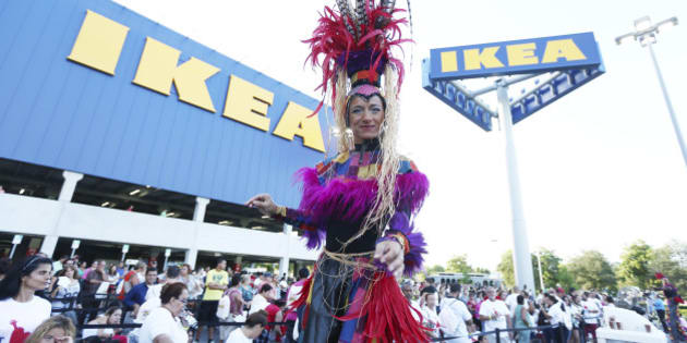 A stilt-walker dances as people wait for IKEA, the world's leading home furnishings retailer. to open the doors of its first Miami-Dade store to customers, in Sweetwater, Fla., Wednesday, Aug. 27, 2014. The 416,000-square-foot IKEA Miami is located on 14.6 acres  It is the Swedish company's second store in South Florida, the fourth in the state, and the 39th in the United States .(AP Photo/J Pat Carter)