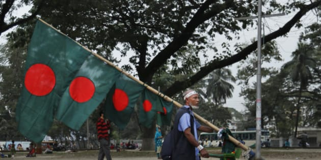 A street vendor carries Bangladeshi flag for sale ahead of Victory Day in Dhaka, Bangladesh, Monday, Dec. 14, 2015. The Victory Day celebrated on December 16 marks the anniversary of Bangladesh' victory in the India-aided war victory against Pakistan. (AP Photo/A.M. Ahad)