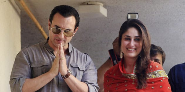 Bollywood stars, Saif Ali Khan, left, and Kareena Kapoor, step out on a balcony to greet waiting fans after getting married in Mumbai, India, Tuesday, Oct. 16, 2012. The Press Trust of India reported the couple married Tuesday in a small official ceremony in Khan's house in Mumbai with a few friends and family members in attendance.  (AP Photo)