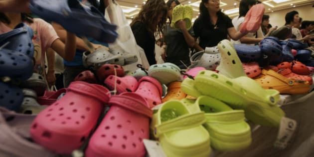 Shoppers choose for clogs during the sale for Crocs footwear at Senayan City shopping mall in Jakarta, Indonesia, Monday, March 15, 2010. The up-to-70%-off sale aimed to sell 80,000 pairs of footwear during the 5-day event. (AP Photo/Irwin Fedriansyah)
