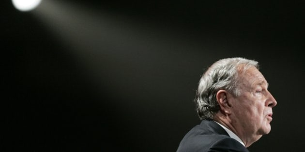 Former Prime Minister Paul Martin salutes the audience during a tribute to the former leader at the Liberal Leadership Convention Thursday, Nov. 30, 2006 in Montreal. (AP Photo/CP,Adrian Wyld)