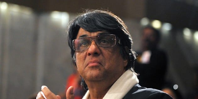Indian Bollywood actor and director Mukesh Khanna looks on during the first beauty & hair industry Lifetime Achievement Awards in Mumbai on late March 24, 2014.  AFP PHOTO / STR        (Photo credit should read STRDEL/AFP/Getty Images)