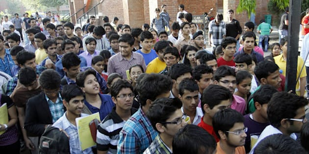 NEW DELHI, INDIA - APRIL 8: Students walk out of the examination center after appearing for IIT JEE 2012 at Modern School Barakhamaba Road on April 8, 2012 in New Delhi, India. As many as 5.6 lakh aspirants across the country appeared for the IIT Joint Entrance Exam 2012. (Photo by Sonu Mehta / Hindustan Times via Getty Images)