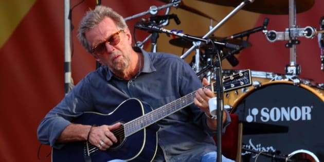"""FILE - In this April 27, 2014 file photo, Eric Clapton performs at the 2014 New Orleans Jazz & Heritage Festival at Fair Grounds Race Course  in New Orleans. Clapton's new album, """"I Still Do,"""" will be released on Friday. (Photo by John Davisson/Invision/AP)"""