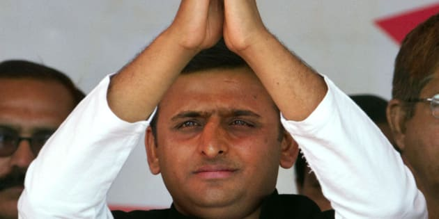 Samajwadi Party (SP) leader Akhilesh Yadav gestures to his supporters during his oath taking ceremony as the Chief Minister of Uttar Pradesh in Lucknow, India, Thursday, March 15, 2012. Yadav, 38, who played a major role in revival of socialist Samajwadi Party fortunes in the recently concluded state elections, is the youngest chief minister of India's most populous state. (AP Photo/Rajesh Kumar Singh)
