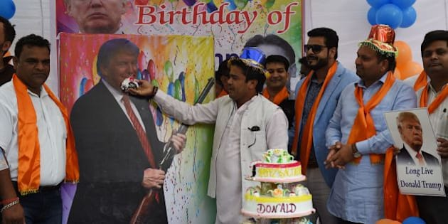 Indian right-wing Hindu activists hold a celebration to mark the 70th birthday of US Republican presidential candidate Donald Trump in New Delhi on June 14, 2016. A far-right Hindu group has previously held prayers in the Indian capital to support the Republican presidential nominee, whose ideas and campaign promises they hail, and with  supporters saying he had the potential to 'save humanity'. / AFP / MONEY SHARMA        (Photo credit should read MONEY SHARMA/AFP/Getty Images)