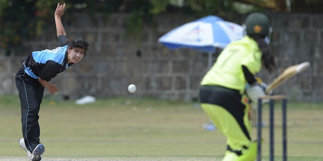 In this photograph taken on April 25, 2016, Pakistani national cricket and football player Diana Baig (L), delivers the ball during a domestic cricket championship match in Islamabad. Baig is no stranger to the pressure. The talented 20-year-old plays for Pakistan's national team in both cricket and football, representing the country as one of the 'Girls in Green' at the recent World Twenty20 tournament in India in between lacing up her boots. / AFP / AAMIR QURESHI / TO GO WITH AFP STORY PAKISTAN-SPORT-CRICKET-FOOTBALL-WOMEN-LIFESTYLE,INTERVIEW BY GOHAS ABBAS        (Photo credit should read AAMIR QURESHI/AFP/Getty Images)
