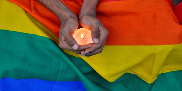A member of the LGBT community in Bengalaru holds a candle during a memorial service following a mass shooting at the Pulse gay nightclub in Orlando, in India June 14, 2016. REUTERS/Abhishek N.Cinnappa