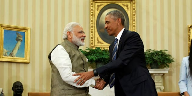 U.S. President Barack Obama (R) shakes hands with India's Prime Minister Narendra Modi after their remarks to reporters following a meeting in the Oval Office at the White House in Washington, U.S. June 7, 2016.  REUTERS/Jonathan Ernst