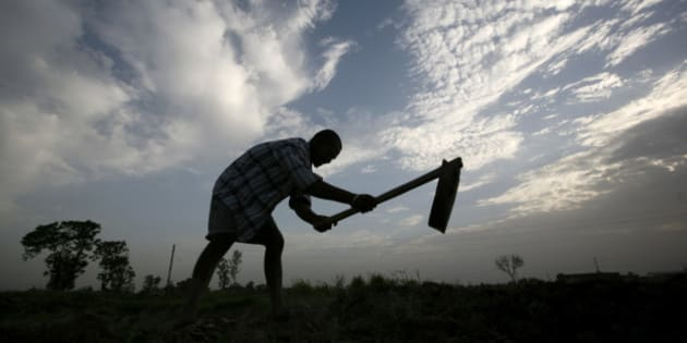 A farmer is silhouetted as he works on a piece of arid land on the outskirts of Amritsar, India, Wednesday, June 24, 2009. India's monsoon rainfall, the main source of irrigation for the country's 235 million farmers, may be below normal this year, the government said on Wednesday. (AP Photo/Altaf Qadri)