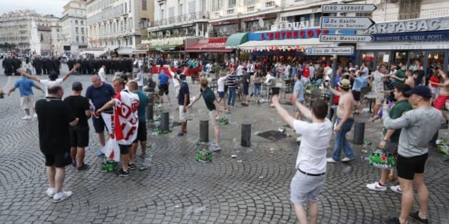 England supporters taunt a line of French riot police officers in downtown Marseille, France, Friday, June 10, 2016.  Scuffles and clashes on Friday and the brief clashes late Thursday revived bitter memories of days of bloody fighting in this Mediterranean port city between England hooligans, Tunisia fans and locals of North African origin during the World Cup in 1998, and raised fears of more violence ahead of Saturday's European Championship match between England and Russia at the Stade Velodrome.(AP Photo/Ariel Schalit)