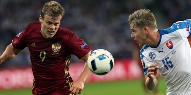 LILLE, FRANCE - JUNE 15: Aleksandr Kokorin (L) of Russia in action against Tomas Hubocan (R) of Slovakia during the UEFA Euro 2016 Group B match between Russia and Slovakia at the Stade Pierre Mauroy in Lille, France on June 15, 2016.  (Photo by Evrim Aydin/Anadolu Agency/Getty Images)
