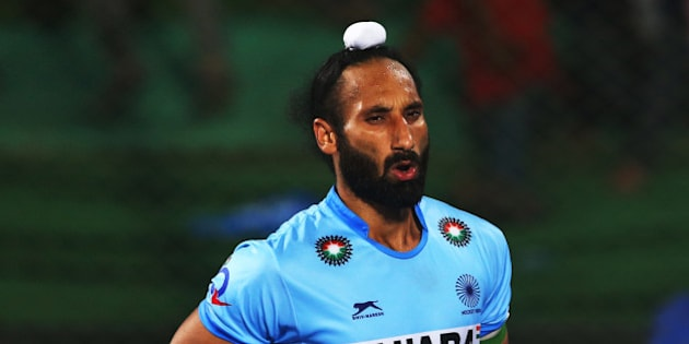 RAIPUR, INDIA - DECEMBER 06:  Sardar Singh captain of India celebrates scoring during the penalty shoot out during the match between Netherlands and India on day ten of The Hero Hockey League World Final at the Sardar Vallabh Bhai Patel International Hockey Stadium on December 06, 2015 in Raipur, India. (Photo by Ian MacNicol/Getty images)
