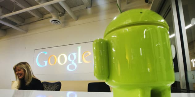 A Google Android figurine sits on the welcome desk as employee Tracy McNeilly smiles at the new Google office in Toronto, November 13, 2012.    REUTERS/Mark Blinch (CANADA - Tags: BUSINESS LOGO SCIENCE TECHNOLOGY TELECOMS)
