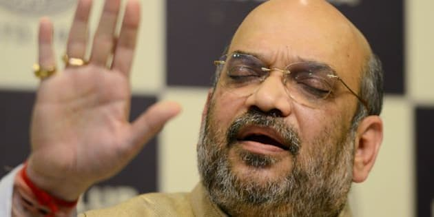 Amit Shah, national president of the ruling Bharatiya Janata Party (BJP), gestures as he answers questions during a press conference in Kolkata on March 29, 2016.  / AFP / Dibyangshu SARKAR        (Photo credit should read DIBYANGSHU SARKAR/AFP/Getty Images)
