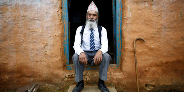 "Durga Kami, 68, who is studying tenth grade at Shree Kala Bhairab Higher Secondary School, poses for a picture wearing his school uniform at the door of his one-room house in Syangja, Nepal, June 5, 2016.  REUTERS/Navesh Chitrakar. SEARCH ""DURGA KAMI"" FOR THIS STORY. SEARCH ""THE WIDER IMAGE"" FOR ALL STORIES.    TPX IMAGES OF THE DAY"