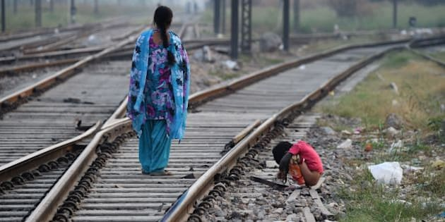 An Indian child defecates in an open near a railway track on International Toilet Day in New Delhi on November 19, 2015.   About 1.1 billion people around the world defecate in the open because they do not have access to proper sanitation facilities. / AFP / SAJJAD HUSSAIN        (Photo credit should read SAJJAD HUSSAIN/AFP/Getty Images)