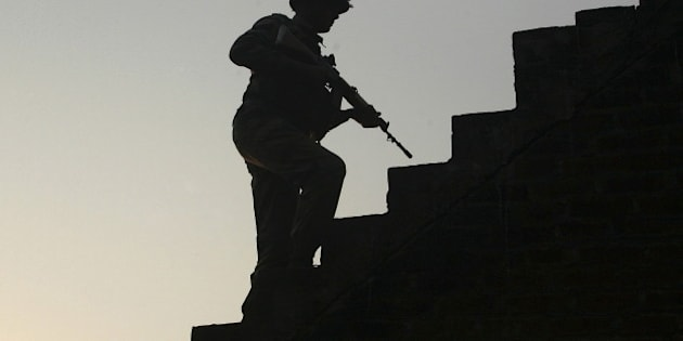 An Indian army soldier climbs up stairs to take his position on the rooftop of a residential house outside the Indian Air Force (IAF) base at Pathankot in Punjab, India, January 3, 2016. Indian security forces battled into Sunday evening to secure an air base near the border with Pakistan, a day after a militant attack that has killed seven military personnel and wounded another 20. REUTERS/Mukesh Gupta