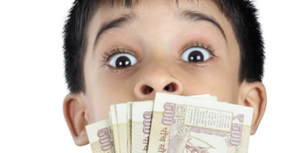 Indian Little Boy With Money