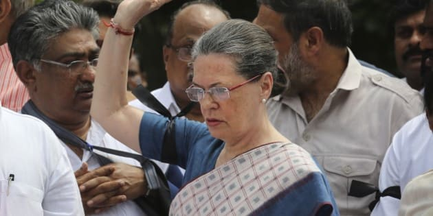 "India's opposition Congress party president Sonia Gandhi, centre, leads other Congress party lawmakers during a protest in the parliament premises, in New Delhi, India, Tuesday, Aug. 4, 2015. Tuesday's protest followed after the speaker of India's Parliament on Monday barred 25 opposition legislators from its sessions for the rest of the week for causing ""grave disorder"" after they created noisy scenes.  The opposition has been demanding that two leaders of the ruling Bharatiya Janata Party resign for allegedly helping a former Indian cricket official facing investigation for financial irregularities. (AP Photo/ Manish Swarup)"