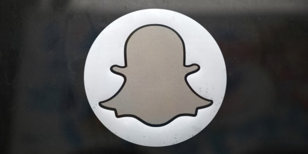 The Snapchat logo is seen on the door of their headquarters in Venice, Los Angeles, California October 13, 2014.  Mobile messaging company Snapchat blamed third-party software apps for possible security lapses that may have led to its users' private photos being at risk of online publication by hackers. A file containing at least 100,000 Snapchat photos has been collected by hackers who were preparing to publish them online, according to a report on the Business Insider blog. Snapchat lets users send photos and videos that disappear in seconds. REUTERS/Lucy Nicholson (UNITED STATES - Tags: BUSINESS SOCIETY SCIENCE TECHNOLOGY TELECOMS LOGO)