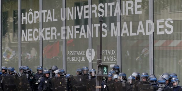 French riot police secure a position outside Necker children's hospital during a demonstration in Paris as part of nationwide protests against plans to reform French labour laws, France, June 14, 2016. REUTERS/Jacky Naegelen