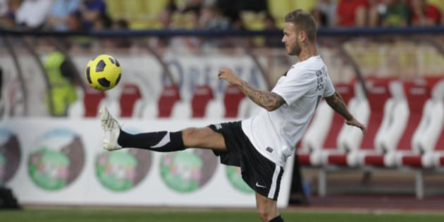 French artist Matt Pokora warms up before a charity match between Olympique Marseille soccer team and a formation of Manchester United with Sir Alex Ferguson, Tuesday, Aug. 2, 2011, in Monaco stadium. (AP Photo/Lionel Cironneau)