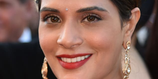 Indian actress Richa Chadha smiles as she arrives on May 15, 2016 for the screening of the film 'Mal de Pierres (From the Land of the Moon)' at the 69th Cannes Film Festival in Cannes, southern France.  / AFP / ALBERTO PIZZOLI        (Photo credit should read ALBERTO PIZZOLI/AFP/Getty Images)